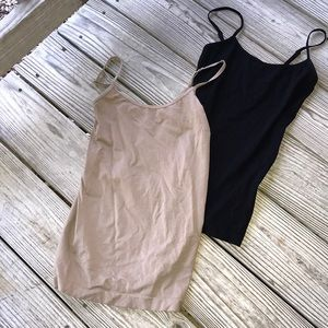 A pair of nude tanks